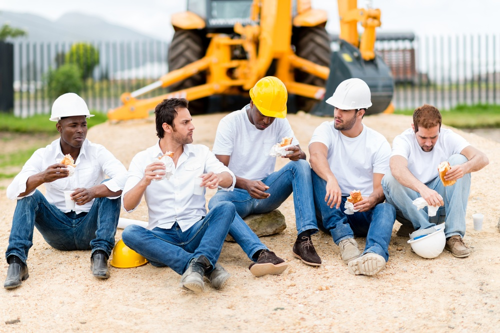 Group of construction workers on a break at a building site.jpeg